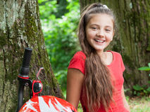 Girl relaxing in the park stock images