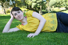Girl relaxing in park Royalty Free Stock Photography