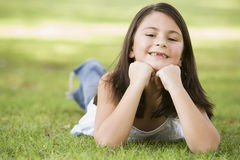Girl relaxing in park Stock Photos