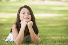 Girl relaxing in park Royalty Free Stock Photo