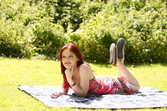 Girl relaxing in park Stock Photo