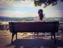 Girl relaxing on a park bench Royalty Free Stock Image