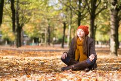 Girl relaxing in park on a fall day Stock Photo
