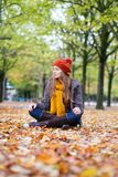 Girl relaxing in park on a fall day Stock Images