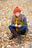 Girl relaxing in park on a fall day Stock Photos