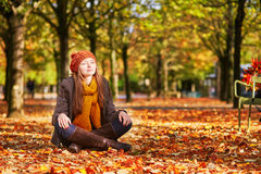 Girl relaxing in park on a fall day Royalty Free Stock Photos