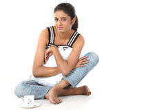 Girl relaxing with pillow and cup of coffee Royalty Free Stock Photo