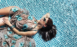 girl relaxing in a pool Royalty Free Stock Photo