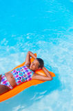 Girl relaxing in a pool Royalty Free Stock Photos