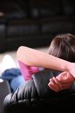 Girl relaxing in recliner Stock Photos