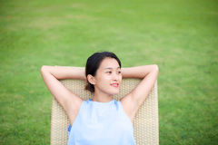 Girl relaxing on a recliner chair Royalty Free Stock Images