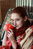 Girl relaxing with a red cup Royalty Free Stock Image