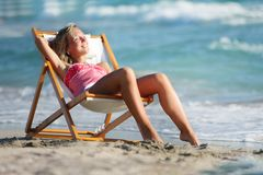 Girl relaxing on sea background Stock Image