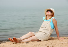 Girl relaxing on sea beach Royalty Free Stock Photo