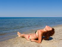 Girl relaxing at sea coast Royalty Free Stock Image
