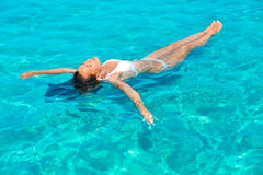 Girl relaxing in the sea Stock Photo