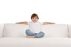 Girl relaxing on settee Stock Images