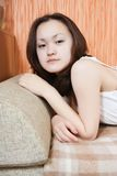 Girl  relaxing on sofa Stock Photos