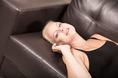 Girl relaxing on a Sofa Royalty Free Stock Images