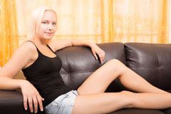 Girl relaxing on a Sofa Royalty Free Stock Photo