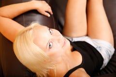 Girl relaxing on a Sofa Stock Photos