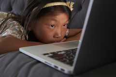 Girl Relaxing On Sofa At Home Using Laptop royalty free stock image