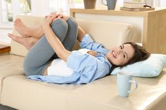 Girl relaxing on sofa Royalty Free Stock Photos