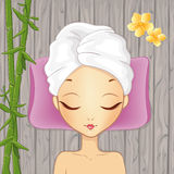 Girl Relaxing In The Spa. Beautiful girl relaxing in the spa on the wood background Royalty Free Stock Photos