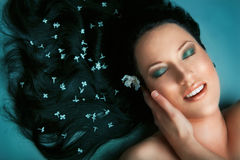 Girl relaxing in spa salon Stock Image