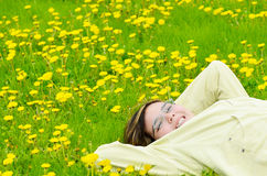 Girl Relaxing In The Sun. A young preteen girl is lying in the grass, relaxing in the sun Stock Photos