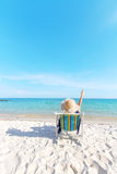 Girl relaxing at tropical beach Royalty Free Stock Image