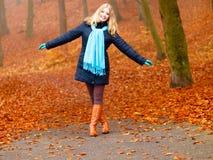 Girl relaxing walking in autumnal park, outdoor Stock Image