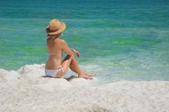 Girl relaxing in the water of Dead Sea stock image