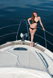 Girl relaxing on a yacht. Royalty Free Stock Images