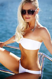 Girl relaxing on a yacht. Young woman is sunning on an motoryacht Stock Photos