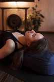 Girl relaxing after a yoga class Royalty Free Stock Images