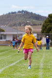 Girl in relay race royalty free stock photo