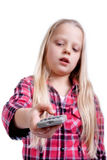 Girl with remote. Stock Photos