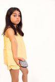 Girl with remote. 8 year old girl changing tv channel with remote control stock images