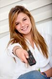 Girl with a remote control Stock Image