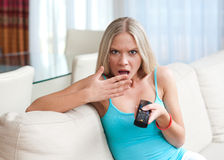 Girl with remote control Royalty Free Stock Photos