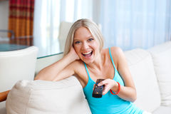 Girl with remote control Royalty Free Stock Images