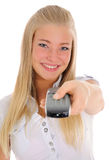 Girl and a remote control. Royalty Free Stock Images