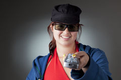 Girl with remote control. Image of a girl wearing 3D glasses and holding remote control Stock Photography
