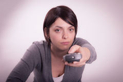 Girl with remote control. On the couch Stock Photos