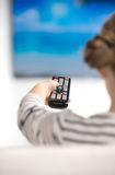 Girl with remote control. Royalty Free Stock Image