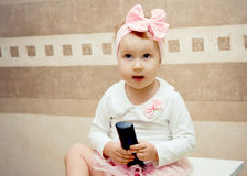 Girl with a remote stock image