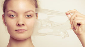 Girl removing facial peel off mask Royalty Free Stock Photography