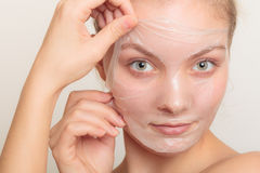Girl removing facial peel off mask Royalty Free Stock Image
