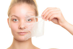 Girl removing facial peel off mask Stock Photography